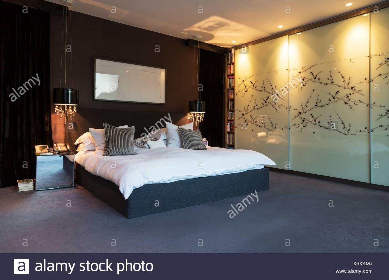 Wall art in modern bedroom - Stock Image