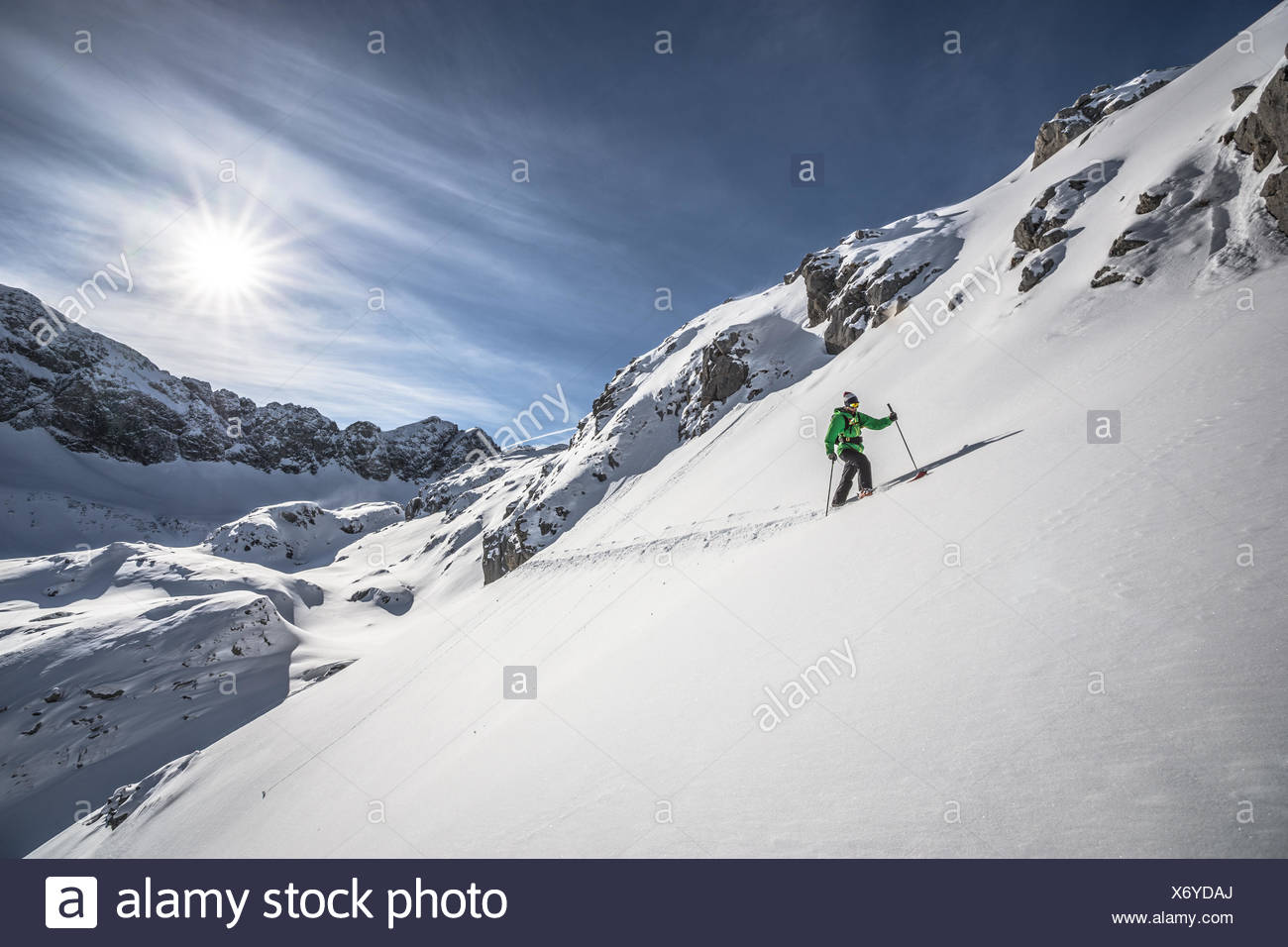 Austria, Male skier heading uphill - Stock Image