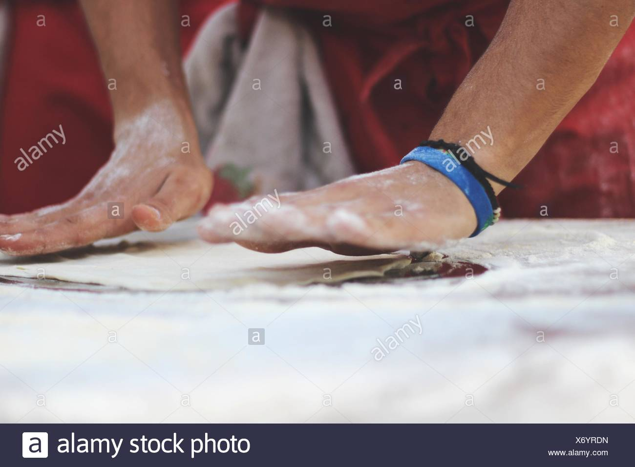 Cropped Image Of Man Kneading Dough At Commercial Kitchen - Stock Image