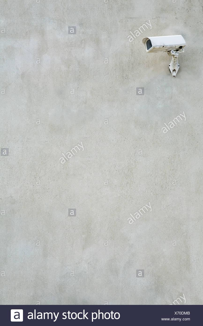 CCTV camera on wall - Stock Image