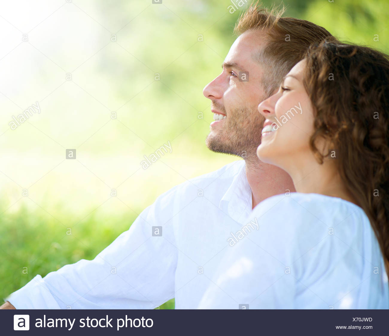 Happy Smiling Couple Relaxing in a Park. Picnic - Stock Image