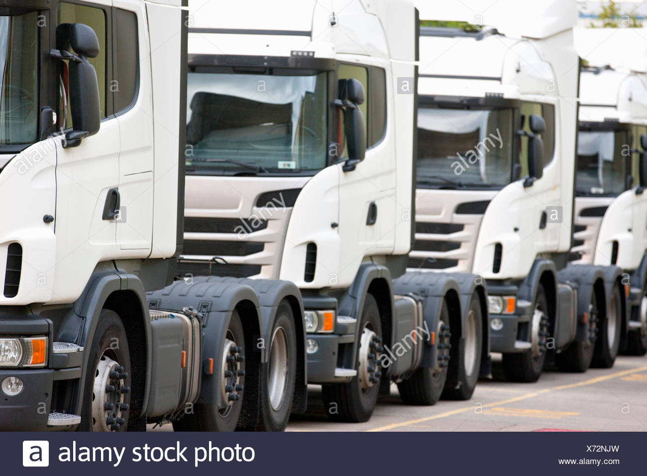 Freight transportation trucks parked in a row - Stock Image