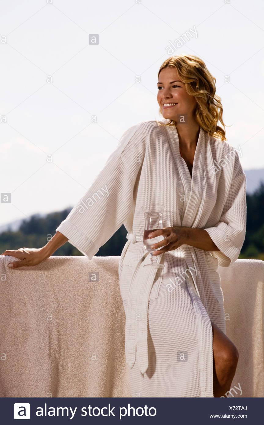 Woman wearing bathrobe 40c98e3db