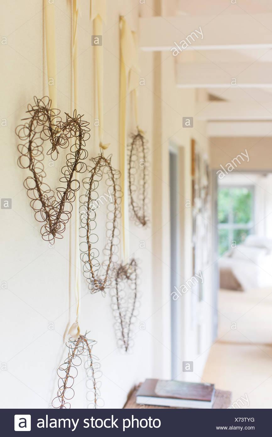 Wall hangings in rustic hallway - Stock Image