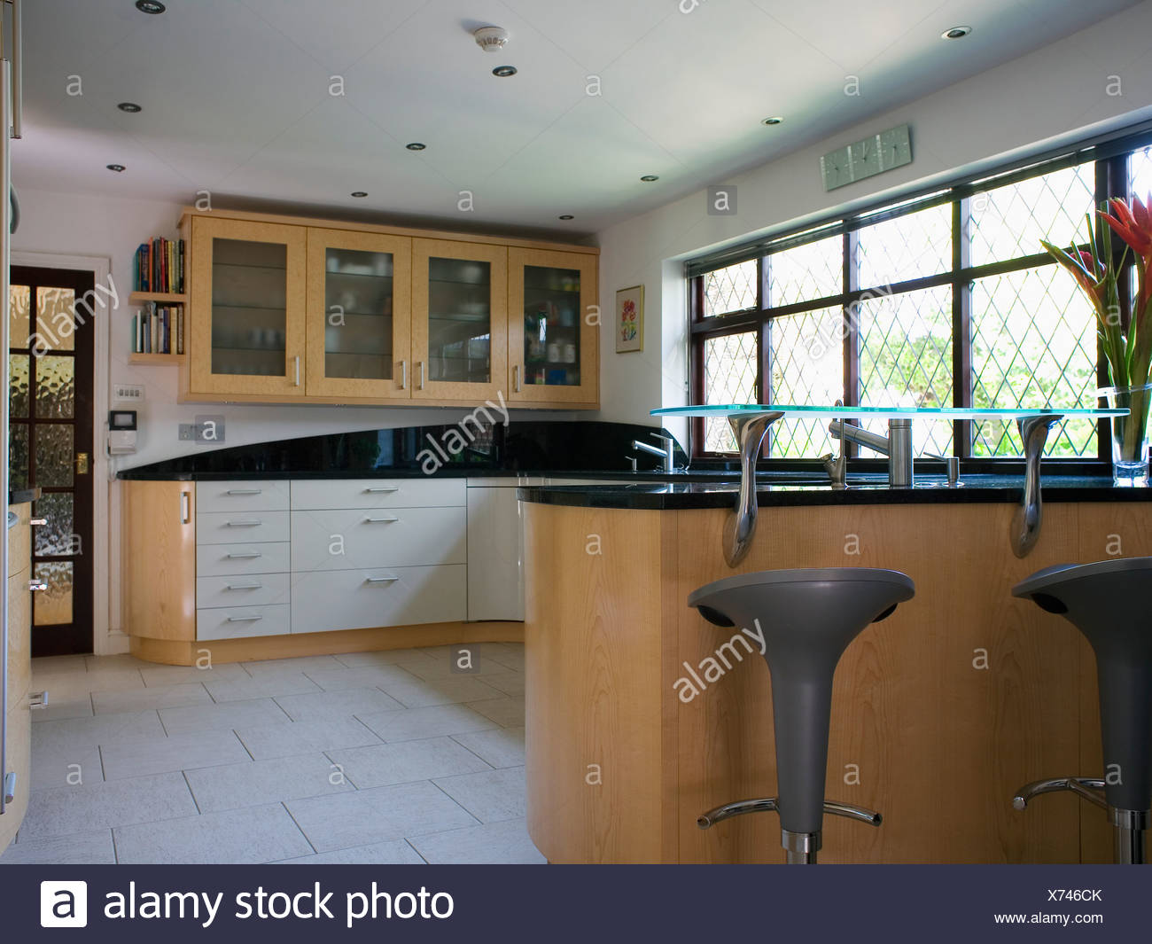 Cream Ceramic Floor Tiles In Modern Country Kitchen With Raised Glass Shelf  On Breakfast Bar