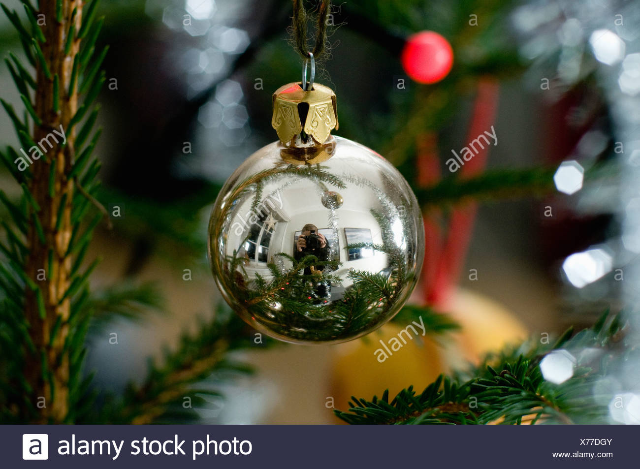 Reflection of photographer on Christmas ball - Stock Image