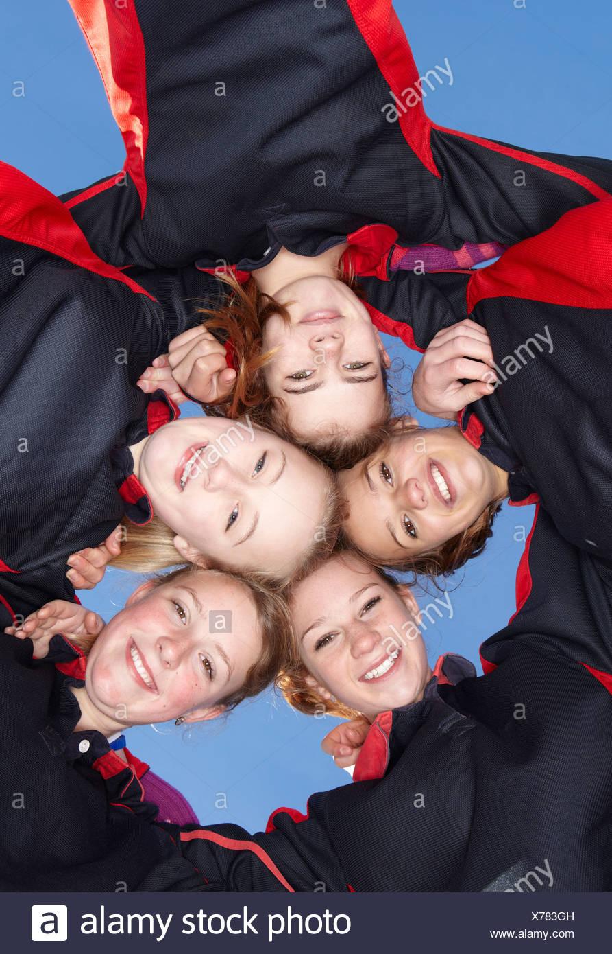 Girls smiling in circle - Stock Image