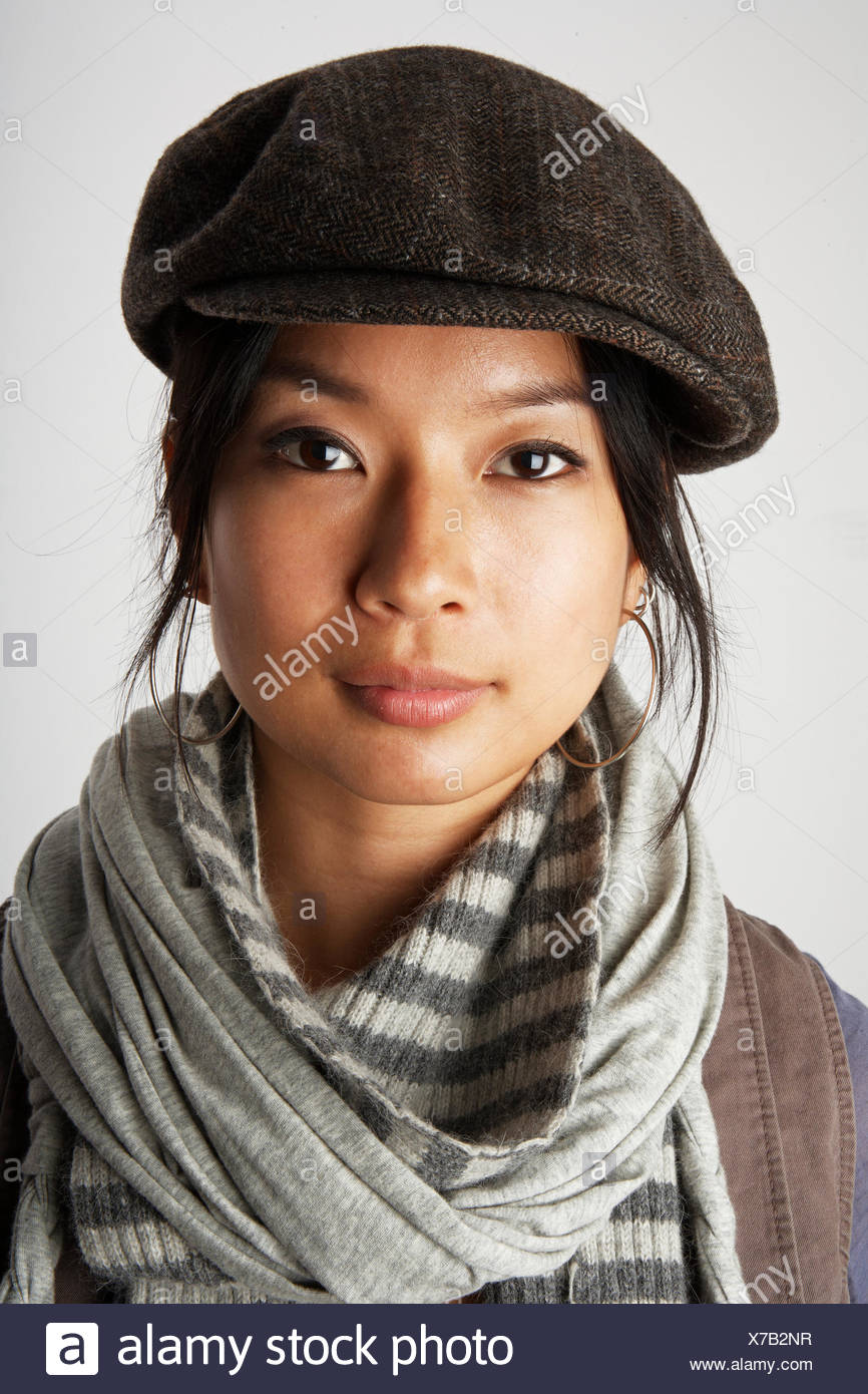 8229f7a5e9c7b Studio portrait of mid adult woman wearing flat cap and scarf Stock ...