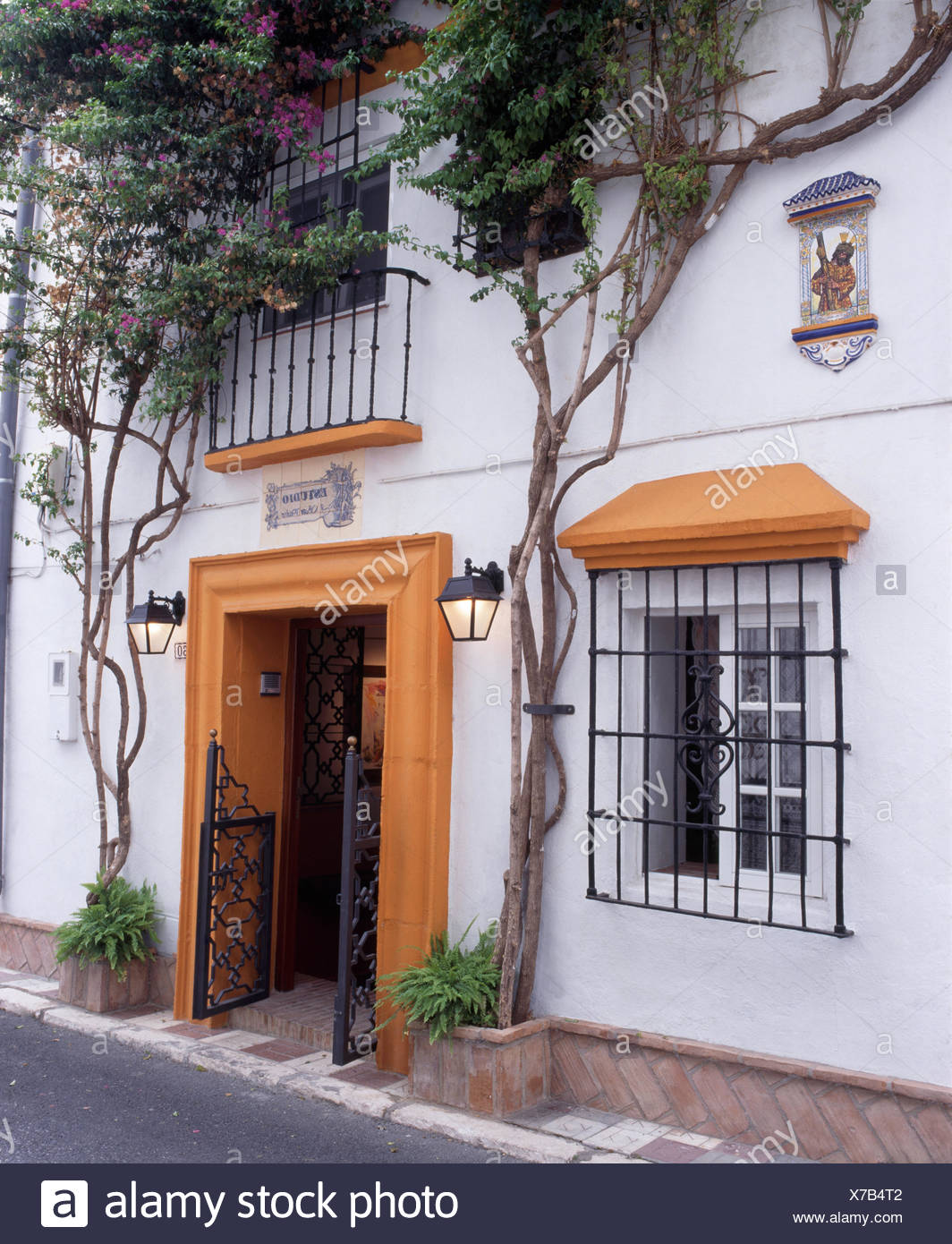 Exterior Of Spanish Villa With Wrought Iron Security Grilles On