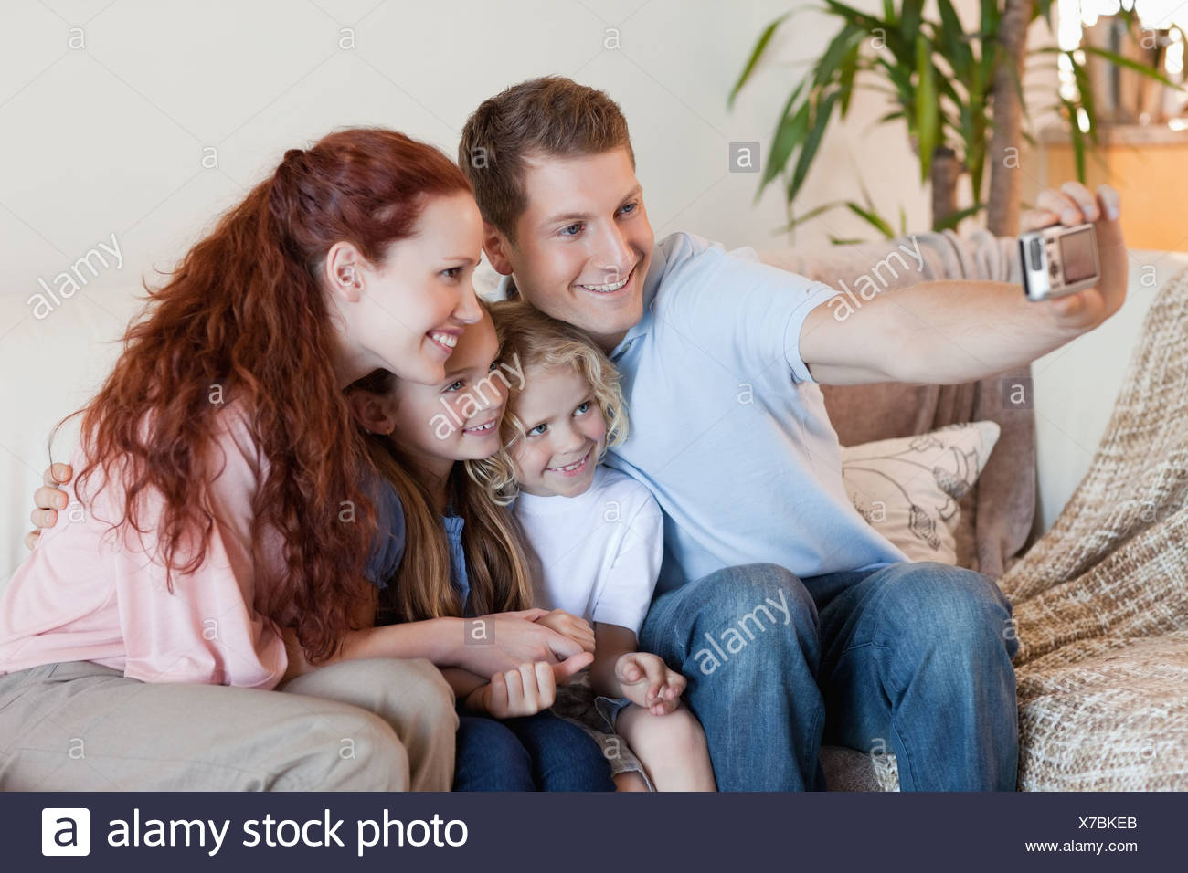 Father taking family photography - Stock Image