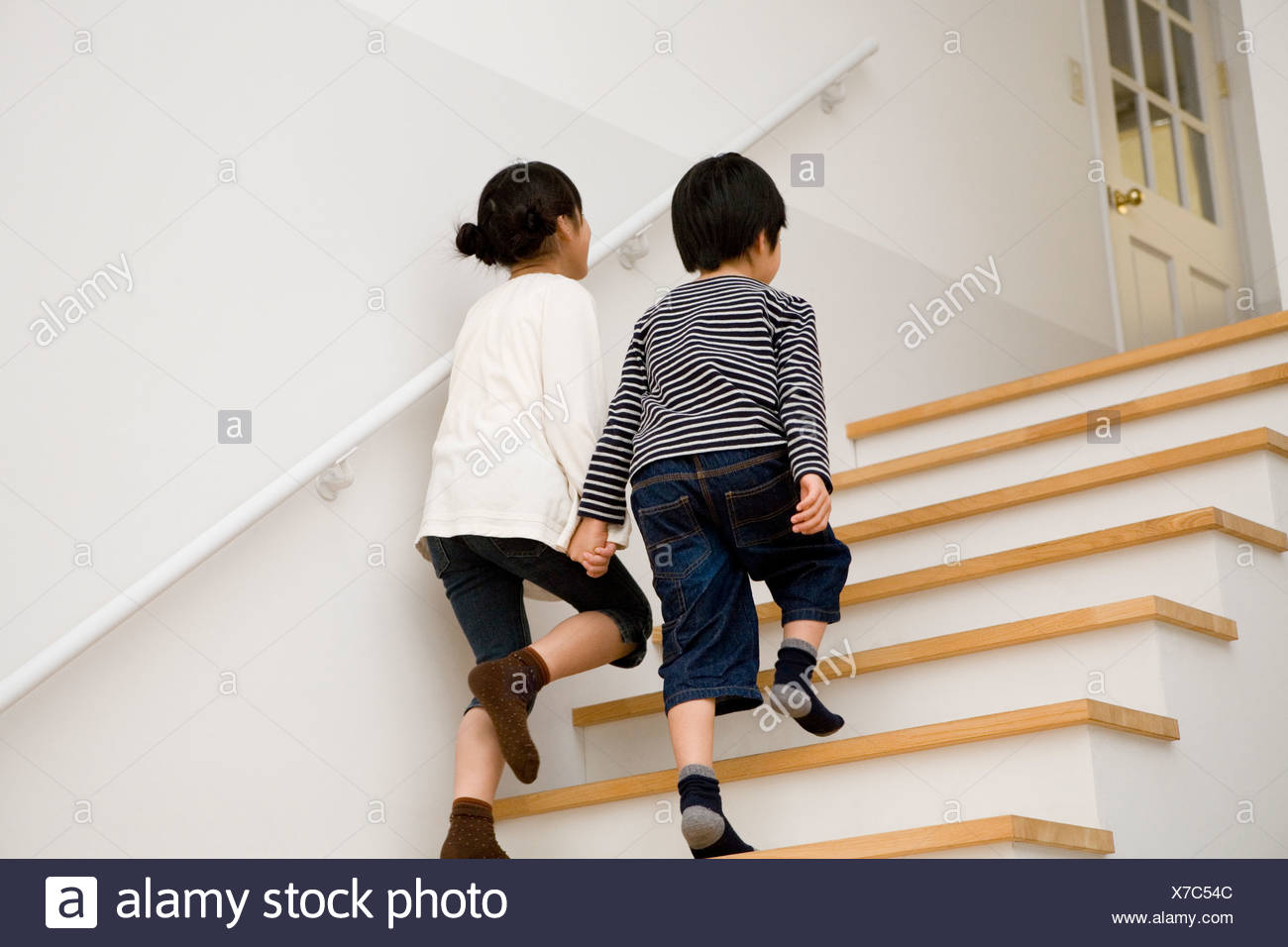 Two Kids Climbing Up Stairs Together
