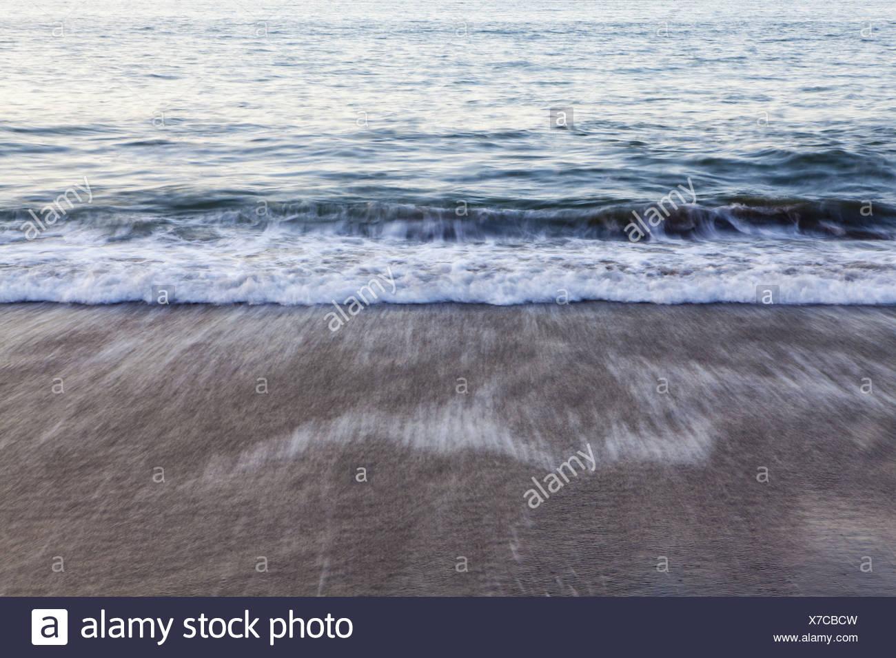 Washington USA Waves breaking on the shore at dusk - Stock Image