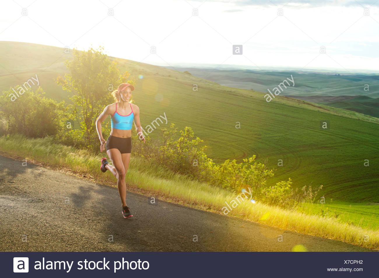Young woman running in landscape of Palouse Hills, Washington, USA - Stock Image