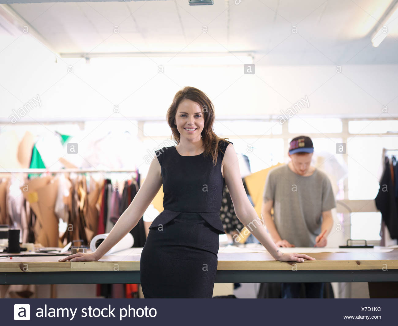 Fashion designer in fashion studio, portrait - Stock Image