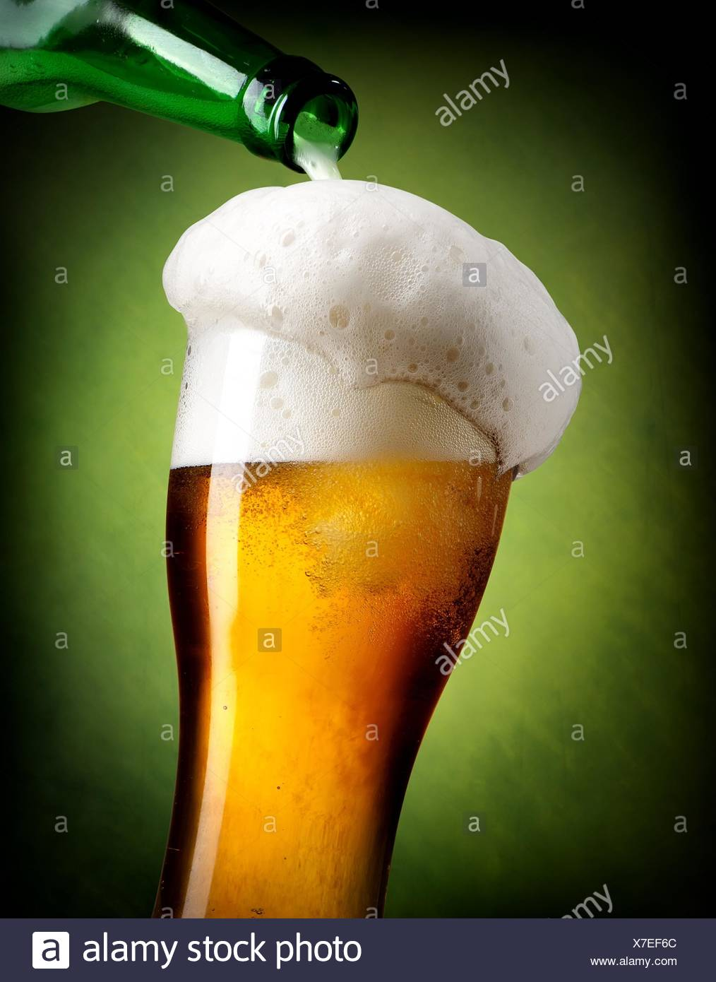 beer pouring into glass on green background stock photo 279987748