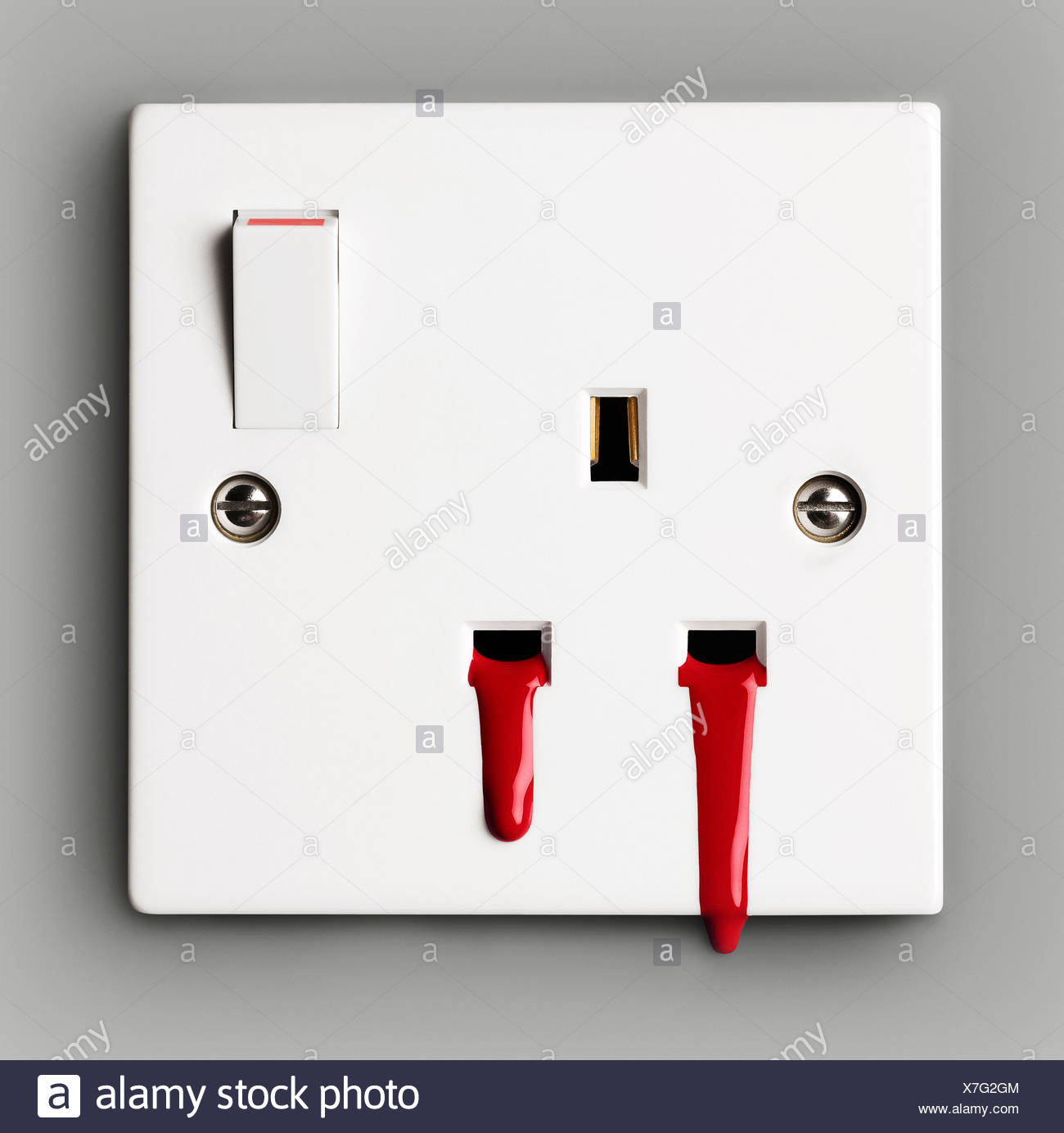 Blood coming out of electrical socket - Stock Image