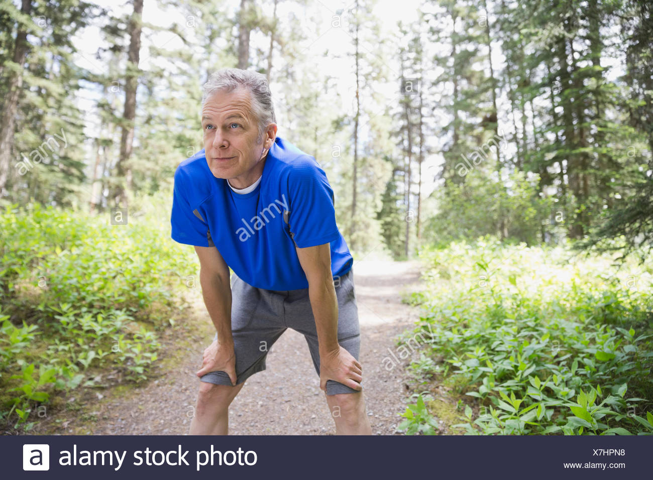 Middle-aged man taking a rest outdoors - Stock Image