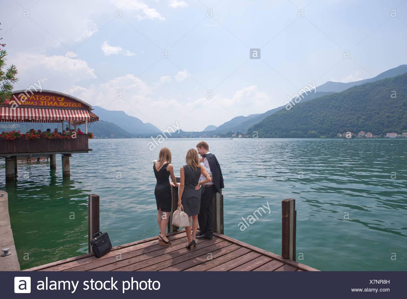 Man, woman, Lake Lugano, Morcote, work, job, occupation, profession, occupations, professions, group, drinking, canton, TI, Tici - Stock Image