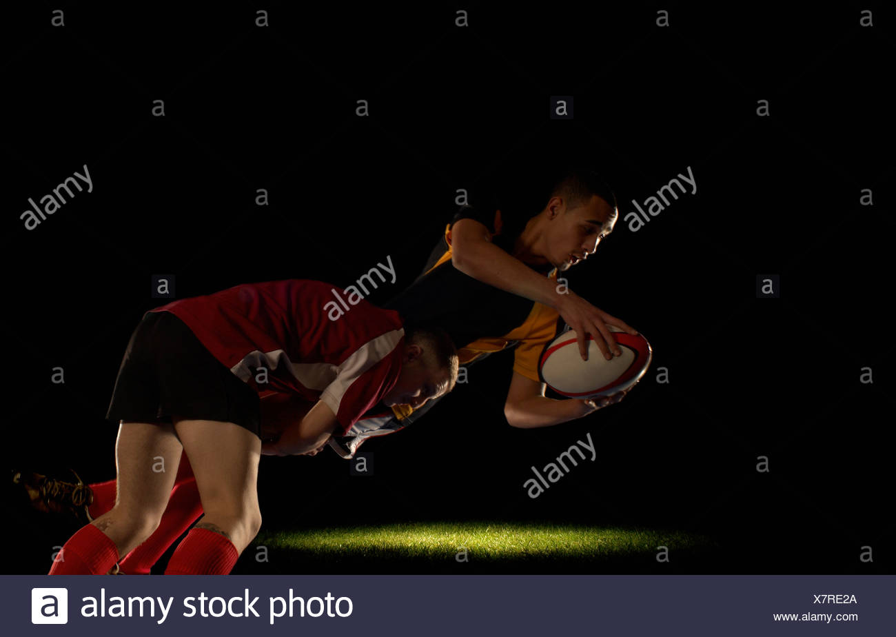 Rugby player being tackled - Stock Image