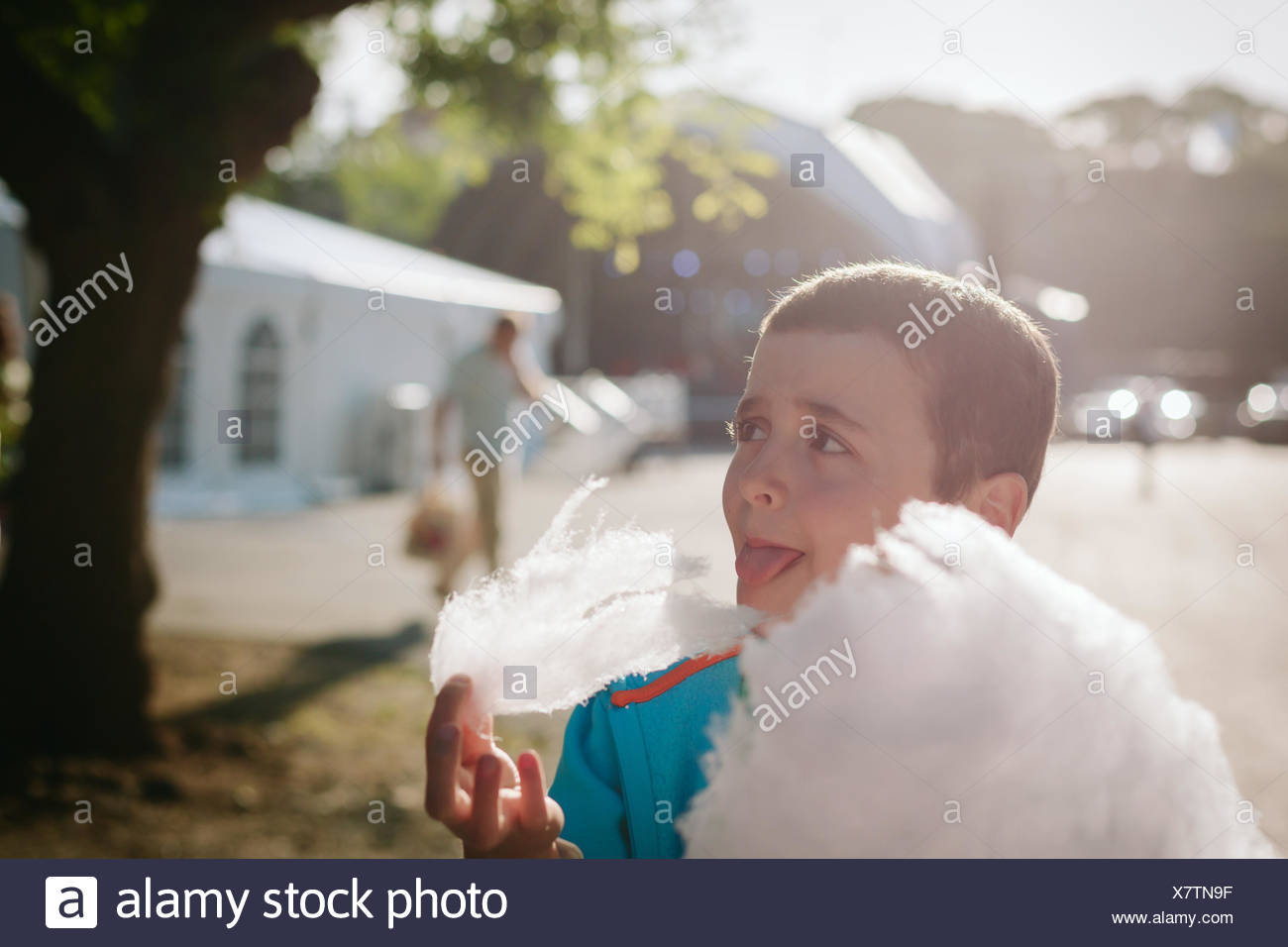 Boy Eating Candy Floss On Sunny Day - Stock Image