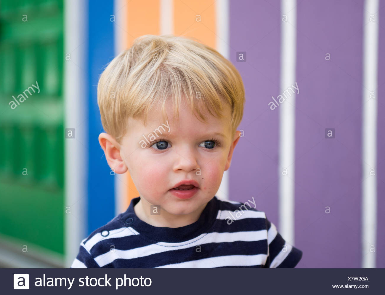 USA, Indiana, Saint Joseph County, Mishawaka, Toddler boy playing by rainbow wall - Stock Image