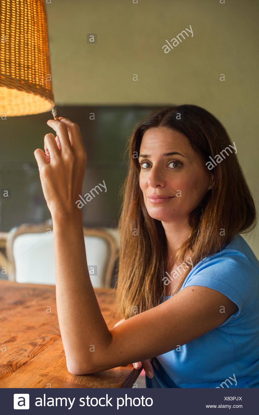 Woman relaxing with cigarette - Stock Image