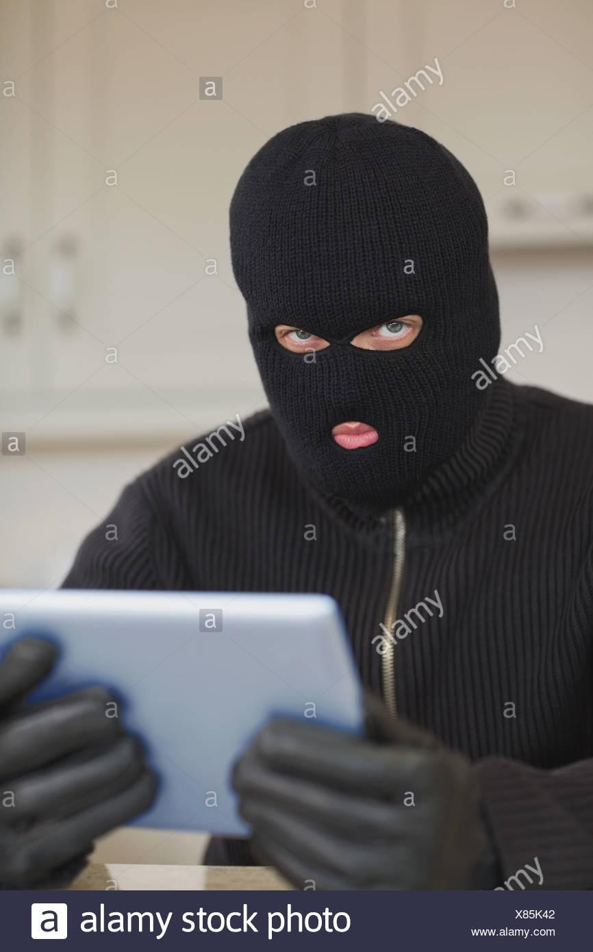 suspicious burgler holding tablet pc stock photo 280407906 alamy