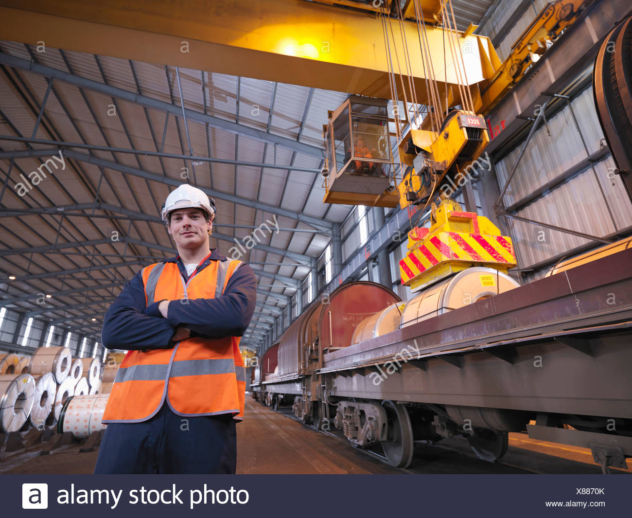 Port Worker In Front Of Train - Stock Image
