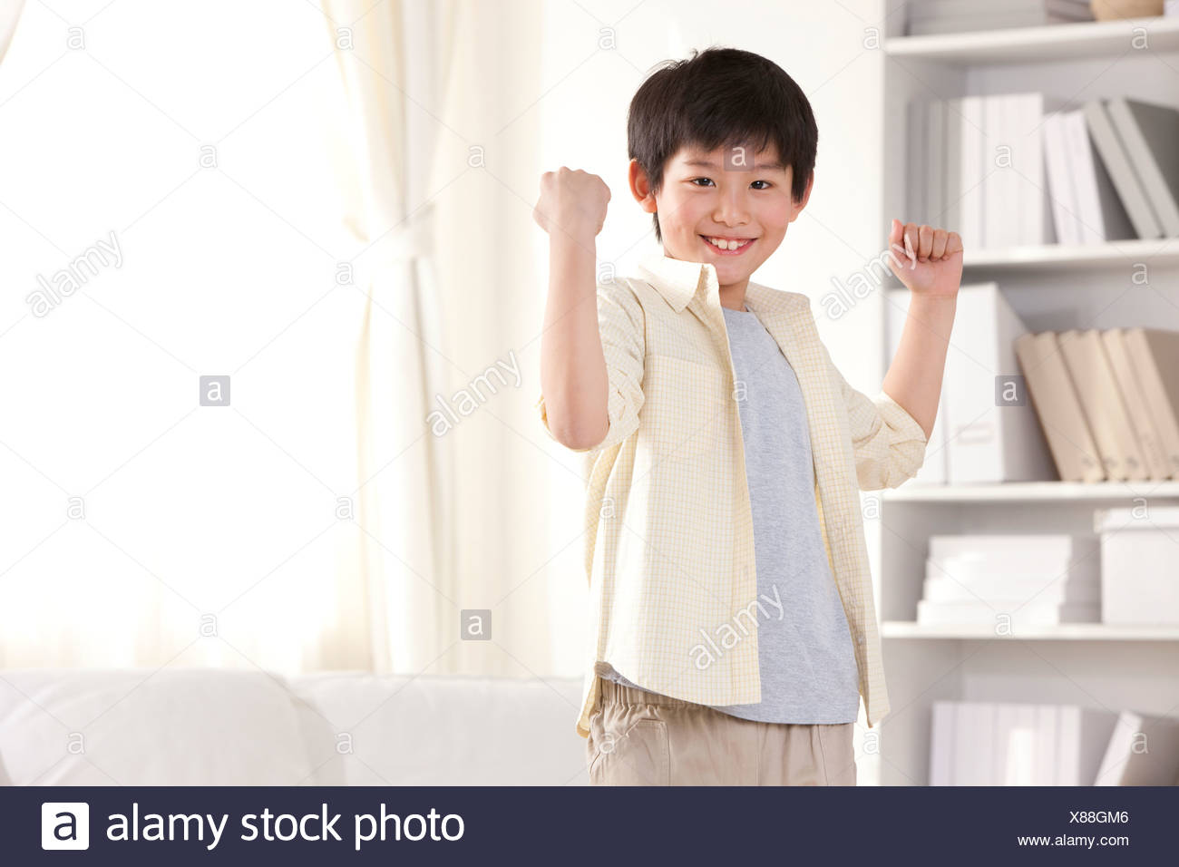 Little boy showing strength - Stock Image