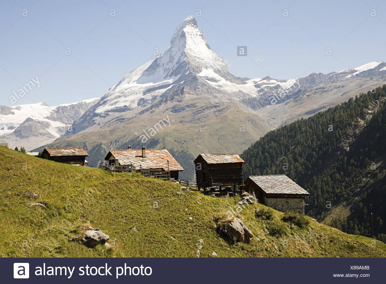 Hillside houses near matterhorn - Stock Image