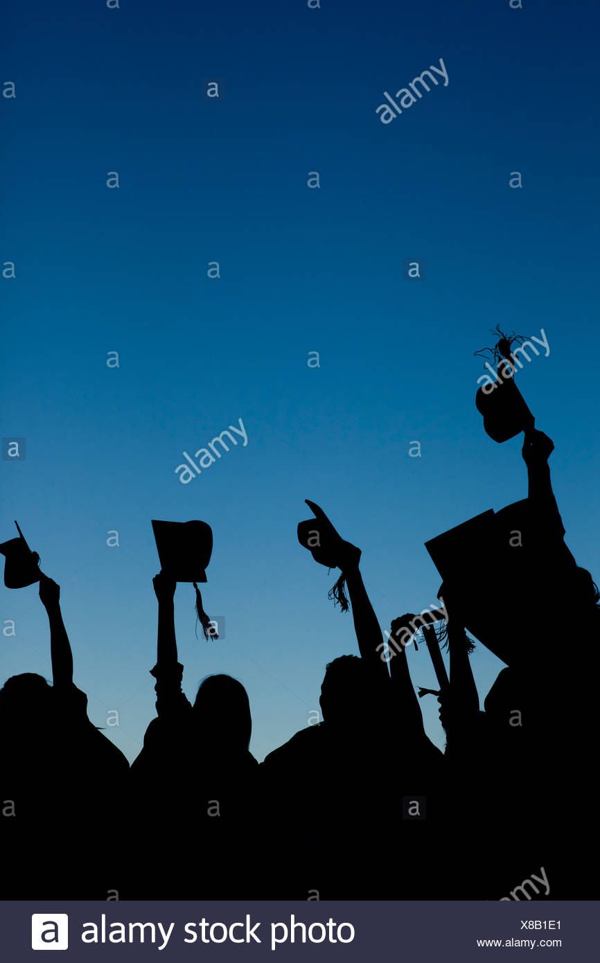Young graduating students celebrating their new graduation - Stock Image