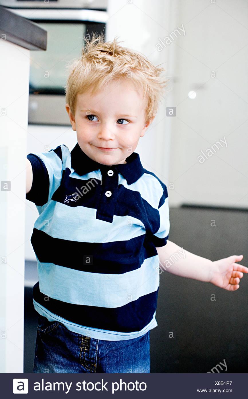 Smiling boy, Stockholm, Sweden. - Stock Image