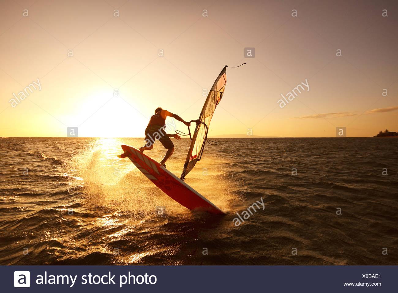 Hawaii, Maui, Kihei, Windsurfer Sailing Off The Coast Of South Maui At Sunset - Stock Image