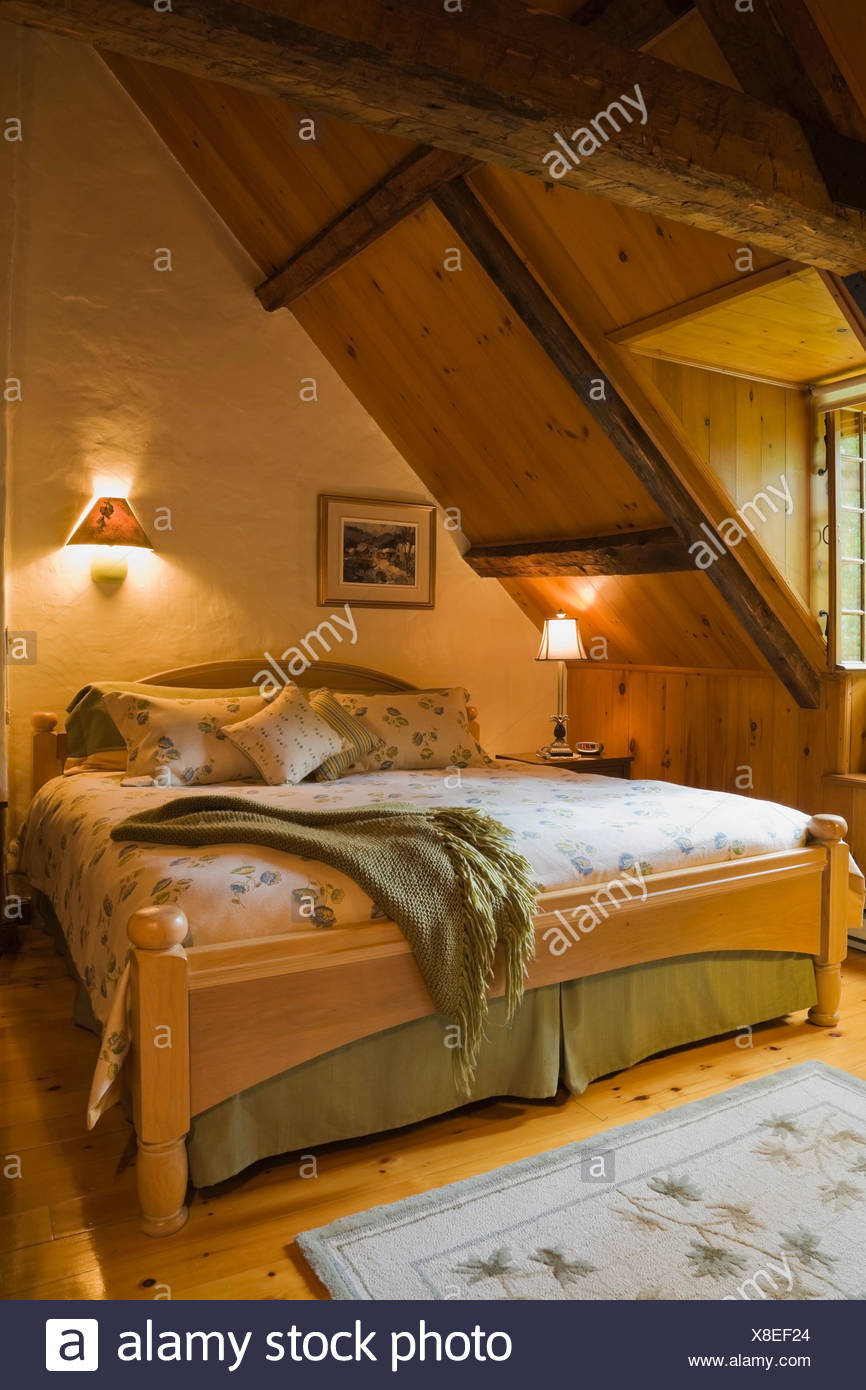 Attic master bedroom of 18th century cottage style home, Quebec ...