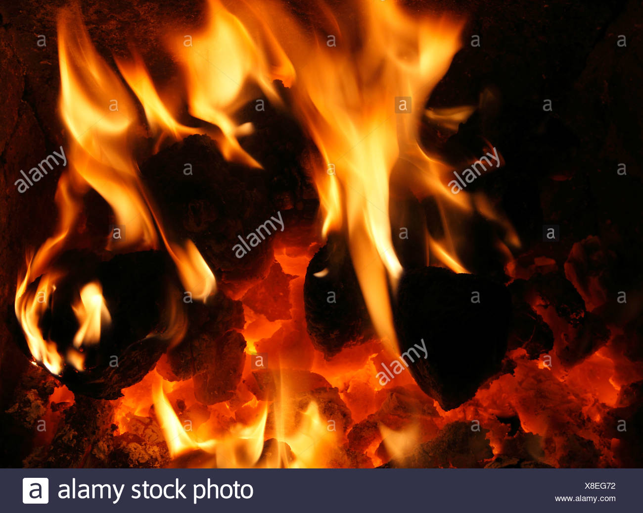Solid Fuel, domestic coal Fire, burning, flame, flames, hearth, fireside, hea,t energy, power, fires, warmth, warm, home, fires - Stock Image