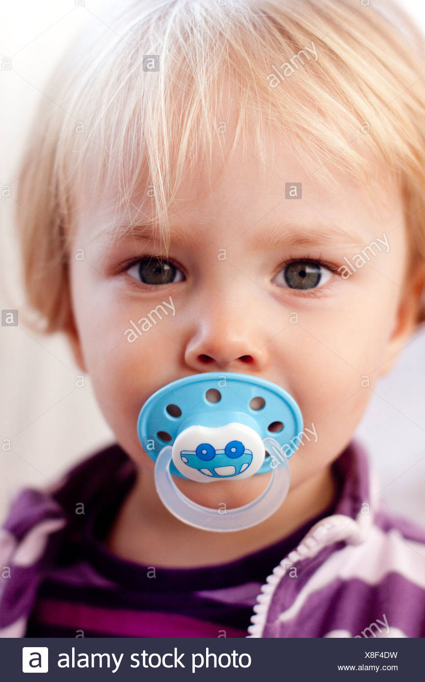 toddler with pacifier stock photo 280615941 alamy