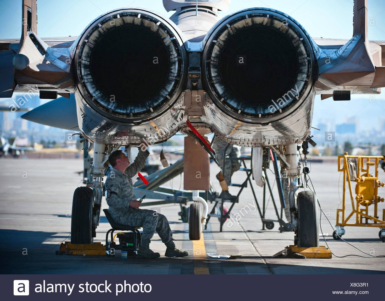 Airman 1st Class Bill Bossinger Tightens Wiring Underneath An F 15 Aircraft Engine Eagle During The Mission Employment Phase Exercise At Nellis