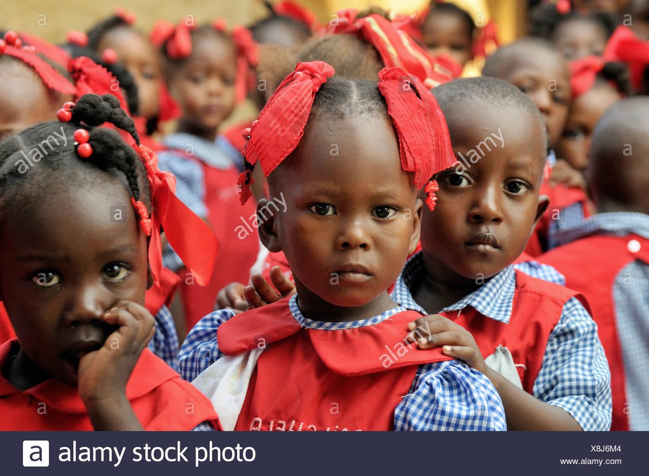 Children wearing school uniforms in a preschool in Leogane, Haiti, Caribbean, Central America - Stock Image