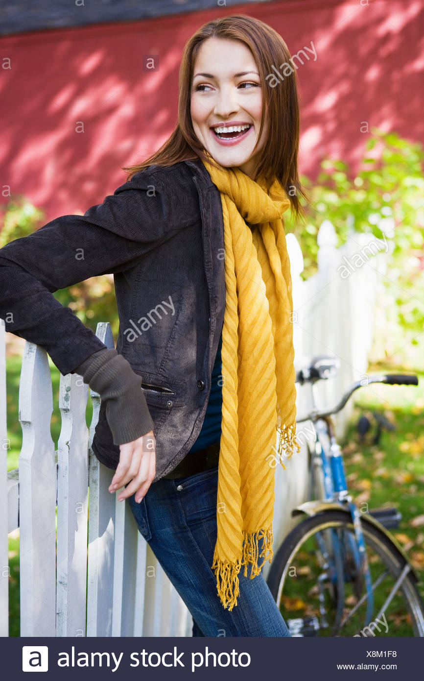 Happy woman outdoors - Stock Image