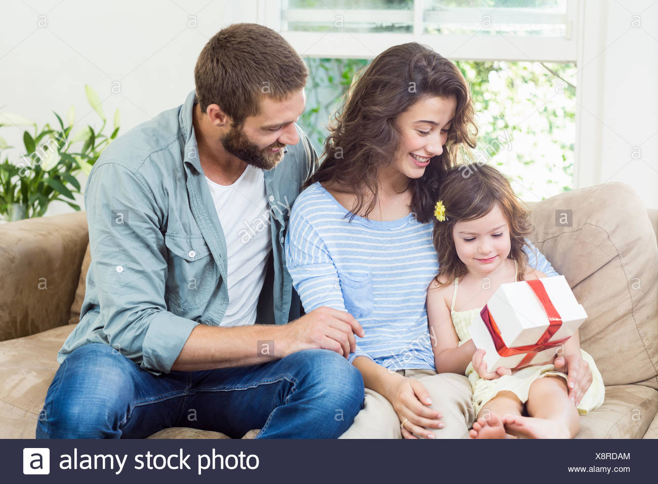 Daughter receiving surprise a gift from her parents