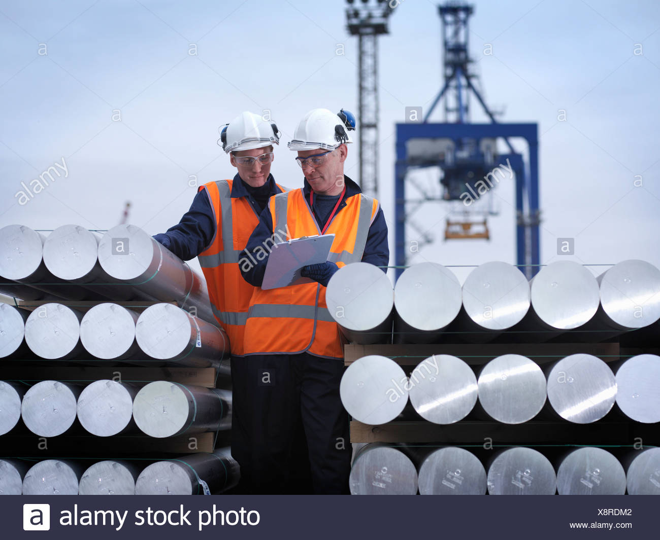 Port Workers Discussing Cargo - Stock Image