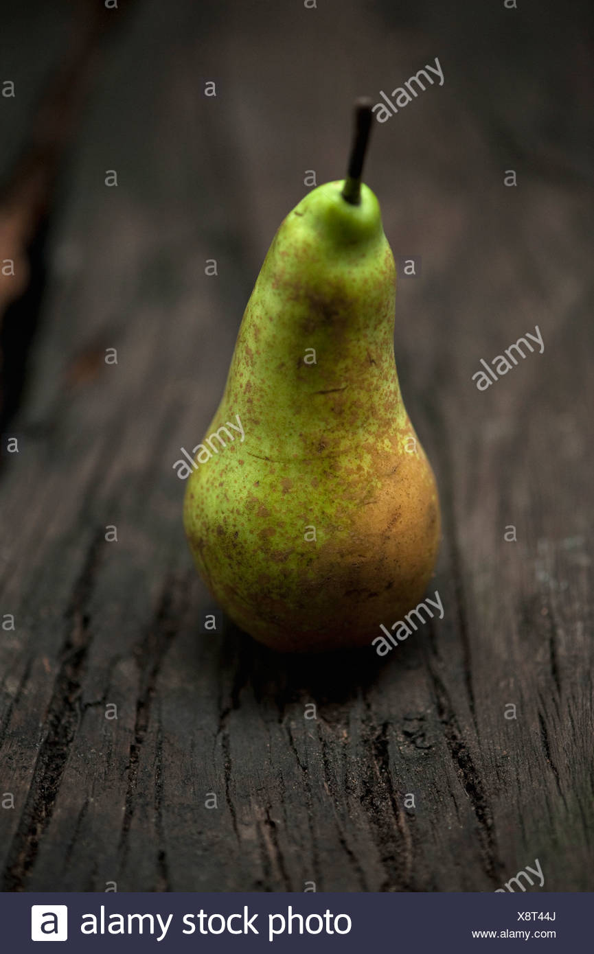 Close up of pear on table - Stock Image