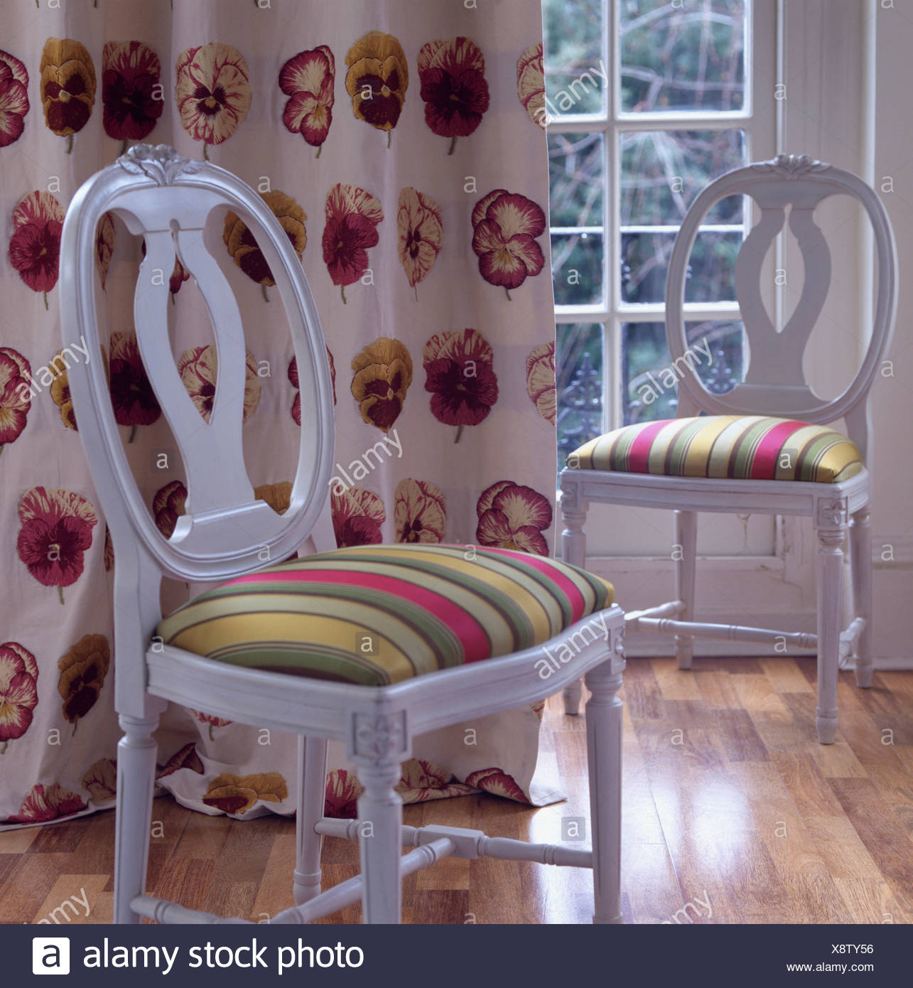 Colorful Striped Upholstered Seats On White French Style Dining