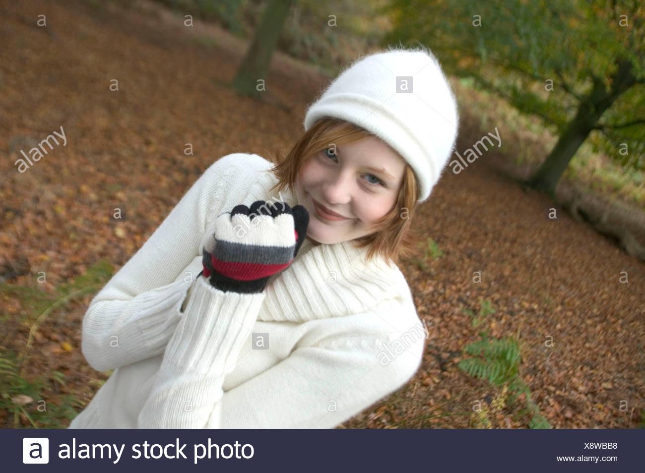 ec8f956b049 Female shoulder length red hair wearing white wool hat