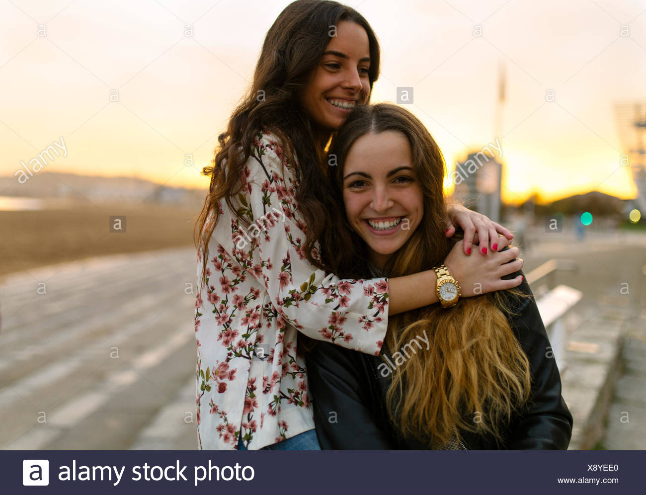 Two happy female friends having fun together - Stock Image