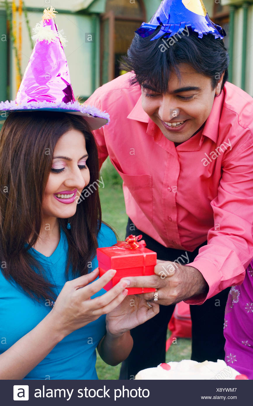 Close Up Of A Young Man Giving Birthday Gift To Woman Stock Photo 280896007