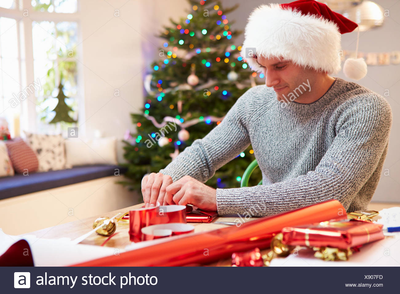 Man Wrapping Christmas Gifts At Home Stock Photo: 280903713 - Alamy