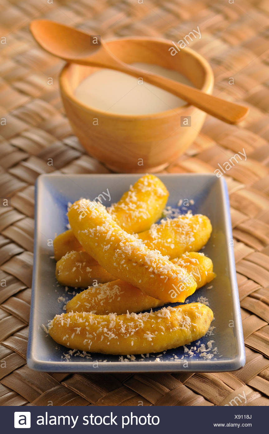 Sweet bananas with coconut - Stock Image