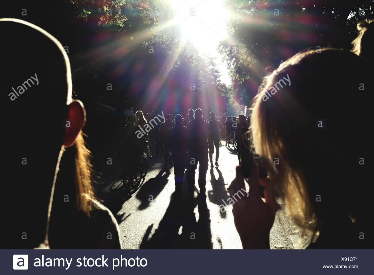 Silhouette People Walking On Road - Stock Image
