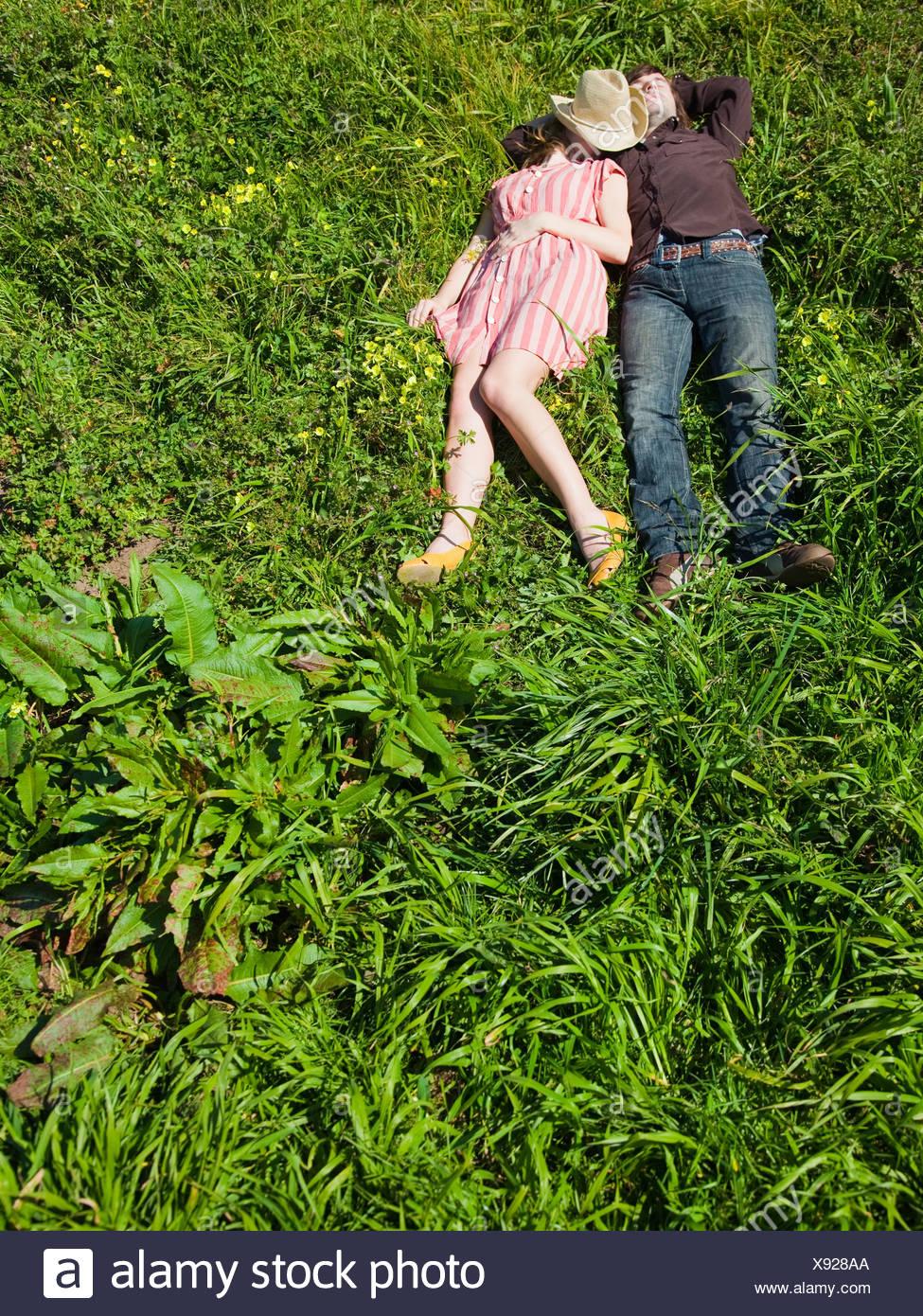 USA, California, San Francisco, young couple lying on back on grass - Stock Image